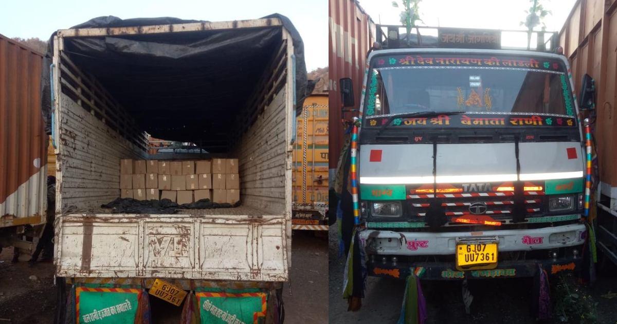 http://www.meranews.com/backend/main_imgs/TruckinLiquor_shamlaji-liquor-truck-bootlegger-gujarat-police-latest-news_1.jpg?97