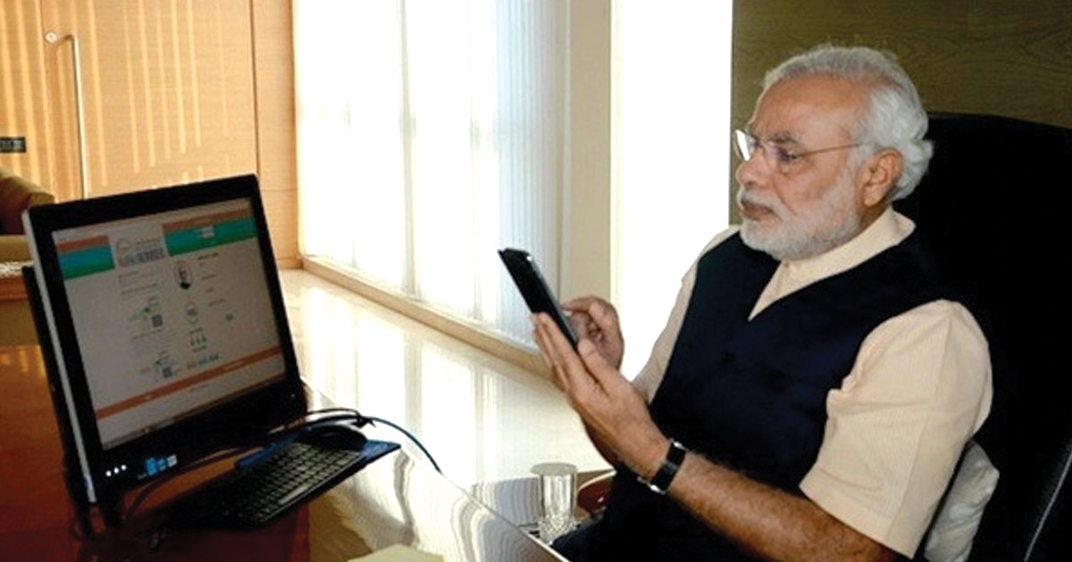 http://www.meranews.com/backend/main_imgs/modi-with-mobile_twitters-crackdown-against-fake-accounts-pm-modi-rahul-ga_0.jpg?96