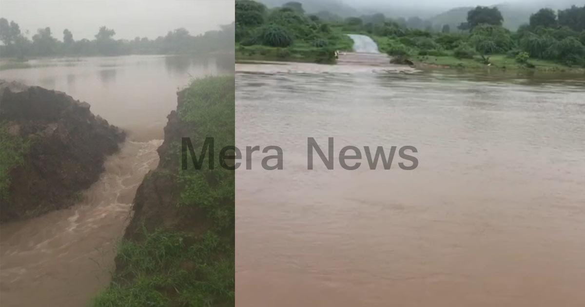 http://www.meranews.com/backend/main_imgs/rainingujarat_limbhoi-lake-broken-peoples-transport-affected_0.jpg?47