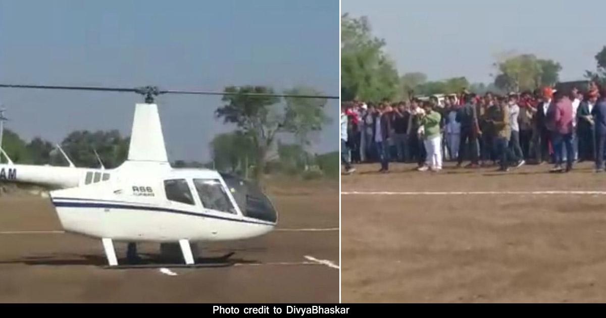 http://www.meranews.com/backend/main_imgs/var_gujarat-dwarka-groom-in-helicopter-helicopter-in-marriage_0.jpg?23